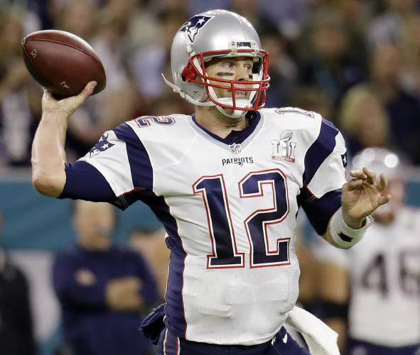 Tom Brady is seen here wearing the jersey that was stolen.