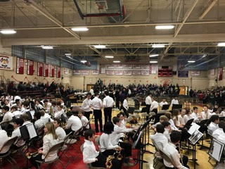 Grades 5-8 begin to settle in their seats as the concert begins.