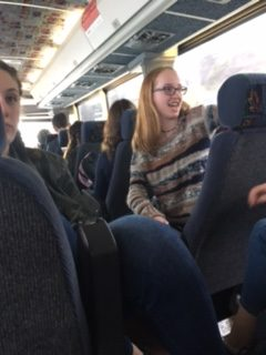 Sophomores Claire Haney and Molly Schwall having fun on the bus.