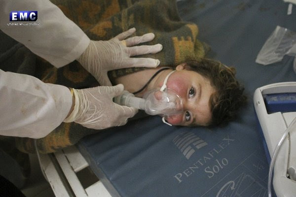A young Syrian boy being treated by a doctor at a make-shift hospital following the devastating chemical attack.