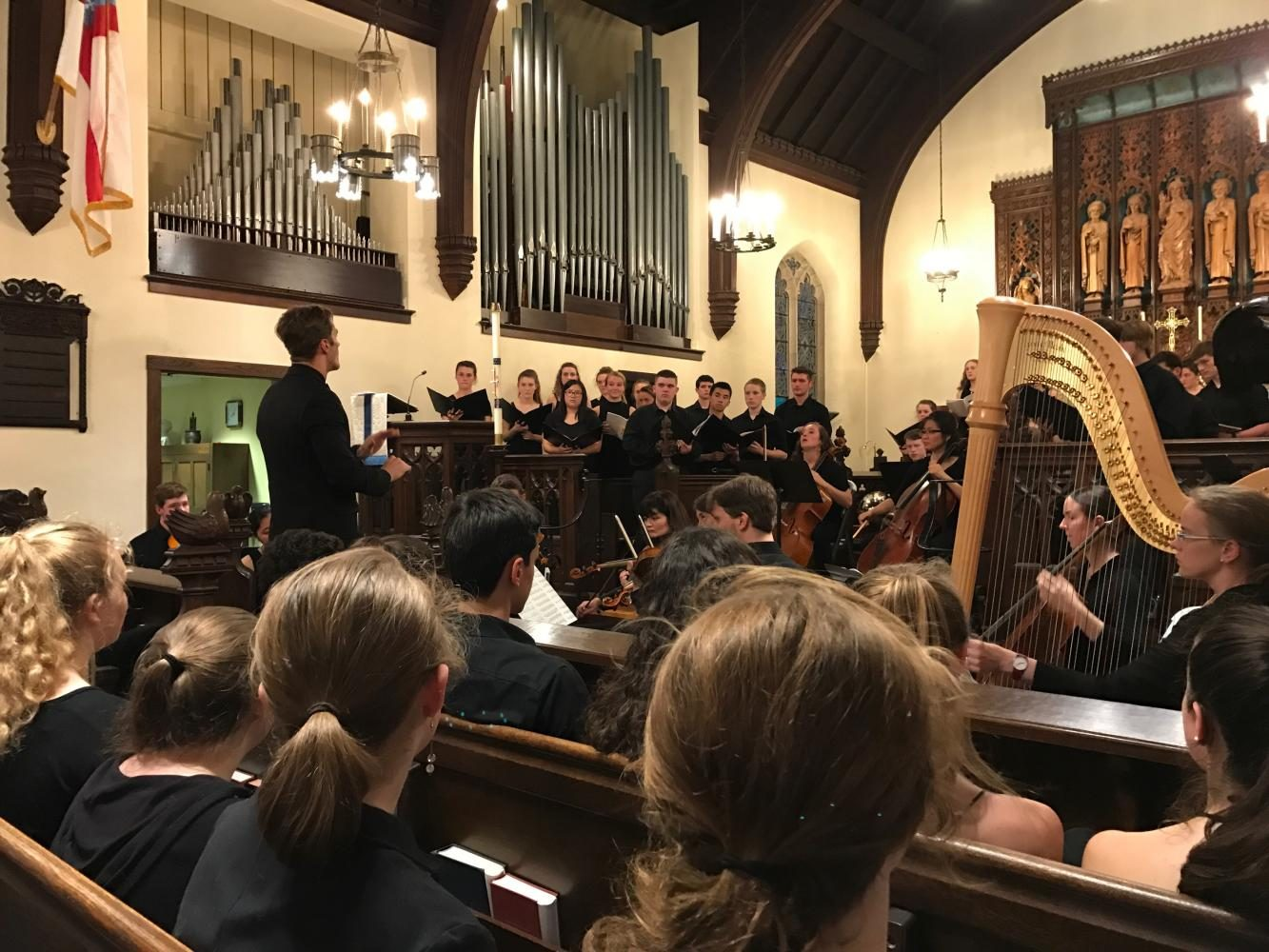 Joseph Young directs Mixed Chorus during their performance of the Fauré Requiem.