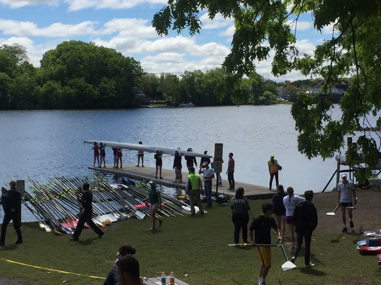 The girls' 1st varsity boat prepares to race in their first heat, which will determine if they qualify for the final.