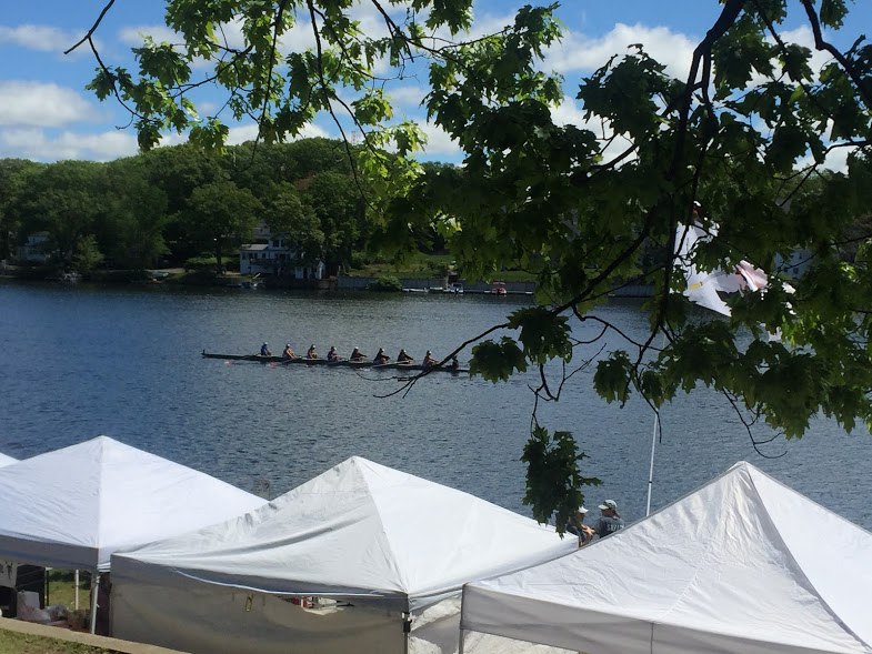 The girls' 1st Varsity boat rows off to the starting line of their first heat.