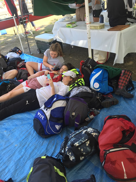 Junior Molly Maravel, freshman Maire O'Driscoll, and sophomore Lauren Colby relax after racing.