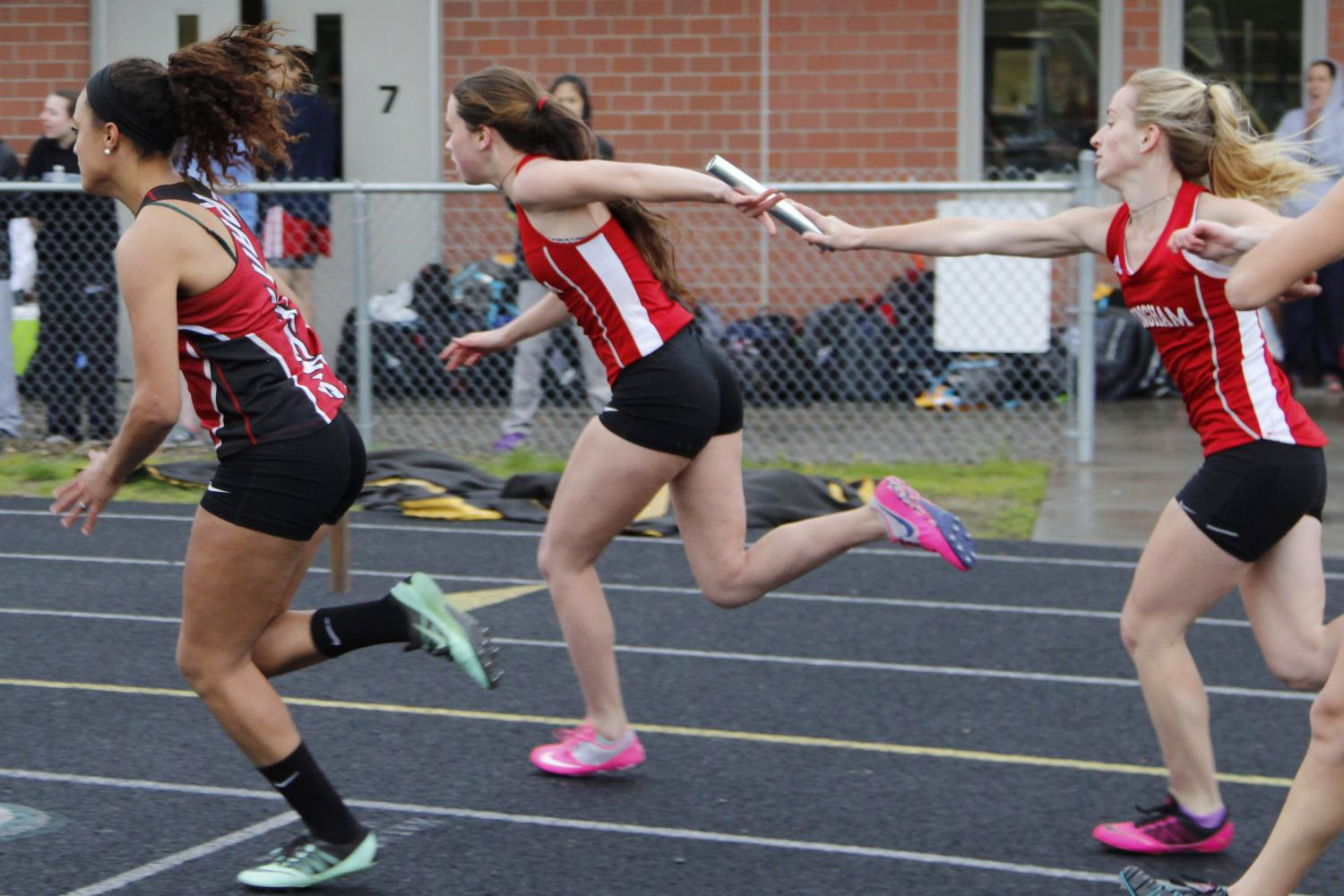 Captain Mary Kate Brennan receives the baton from Emily Brazel in the 4x100m relay.