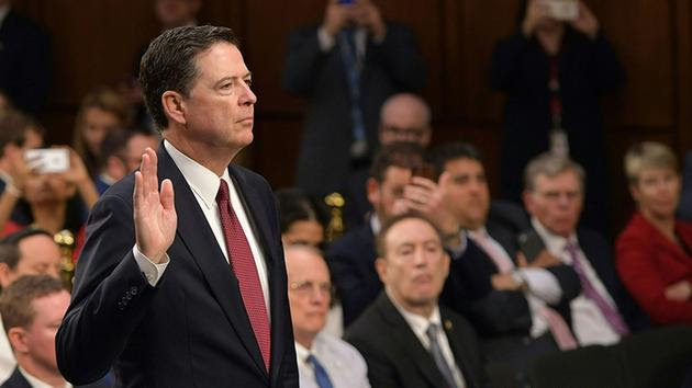 Comey+taking+oath+at+the+hearing%2C+swearing+to+tell+the+truth+and+nothing+but+the+truth.+