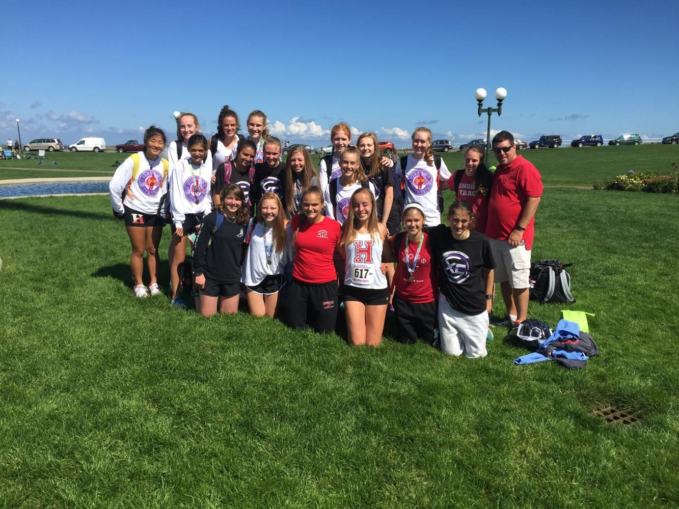 The+Hingham+Girls%27+Cross+Country+team+at+Oak+Bluffs+pose+by+the+water%2C+right+after+finishing+their+races.