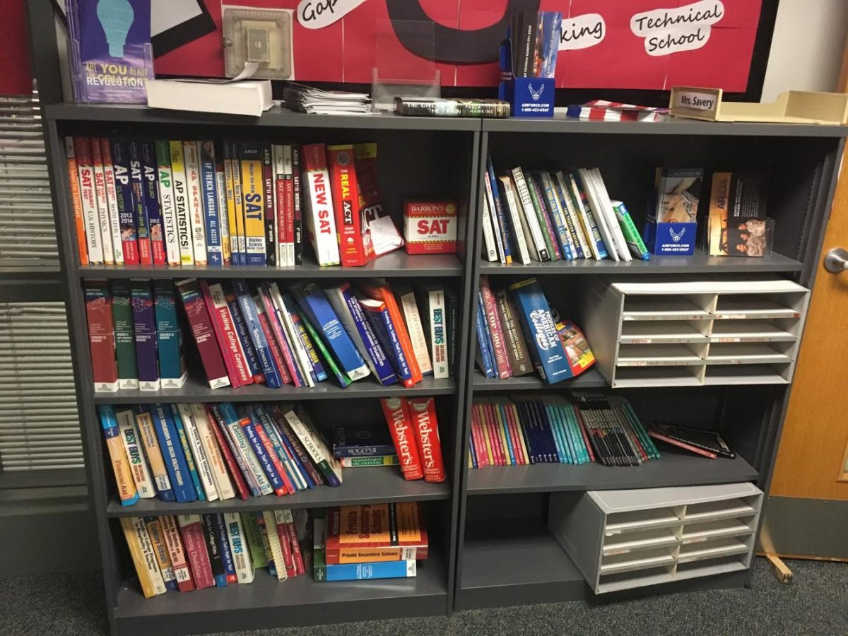 Bookshelf in counselor Ms. Rapoza's office containing both ACT and SAT prep books.