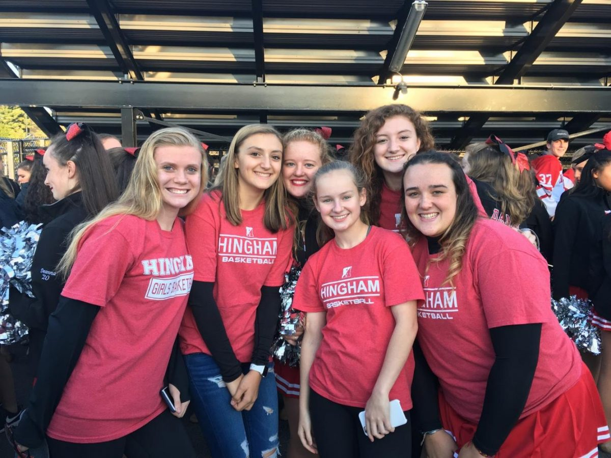 Some of the The Hingham Girls basketball team gather to support the Hingham varsity girls and Mrs. Conaty. Left to right: Shannon Joyce, Riley Blasetti, Lindsay Potter, Grace Bennis, Haley Blasetti, Ellie Holler.