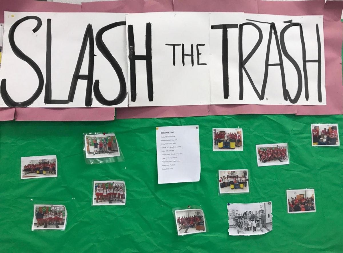 A bulletin board displays the Slash the Trash schedule and photos from previous years.