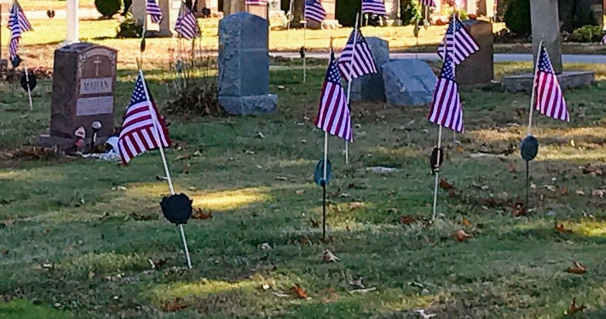 American flags wave in a Hingham cemetery as a sign of respect for those who have fought for our country.