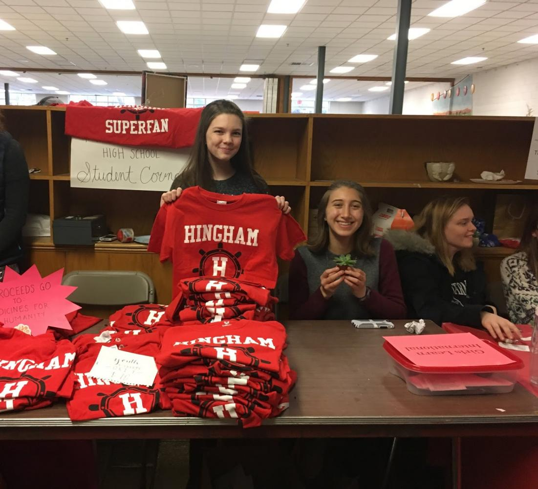 Freshman Emma Meyers representing Hingham High School's Student Council and Shira Berkin representing Girls Learn International.