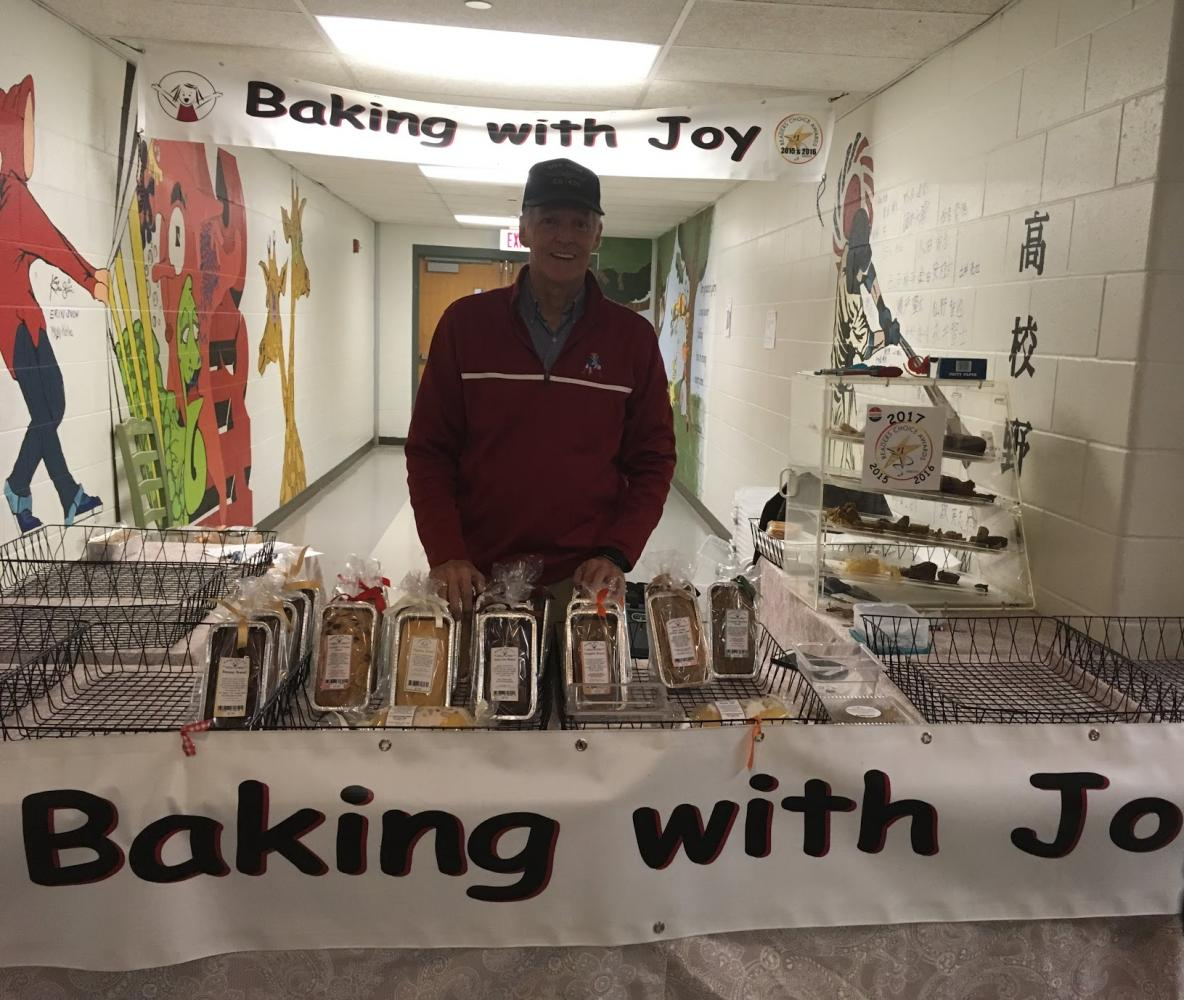 Wendell Davis representing his business at the Holiday Fair with only the few baked goods left after many purchases on Saturday morning.