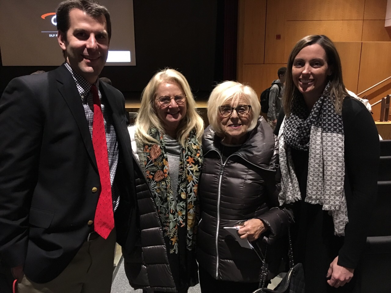 Mr. Louchheim, Judi Bohn, Janet Singer Applefield, and Mrs. McCash smiling after the moving presentation by Applefield.