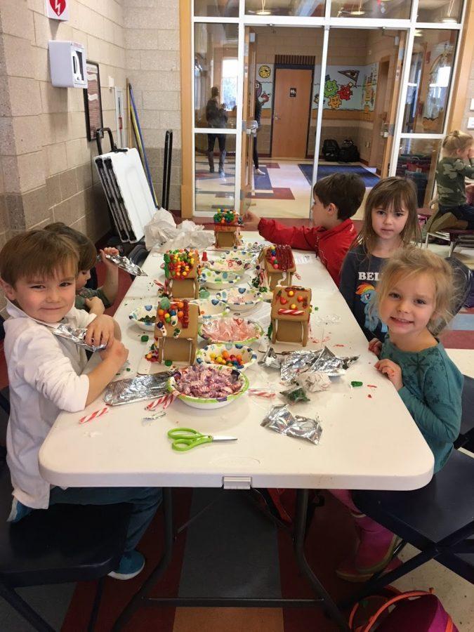Kindergartners Hayes Harolds, Faris Williams, and Rowan Deyoung display their candy creations.