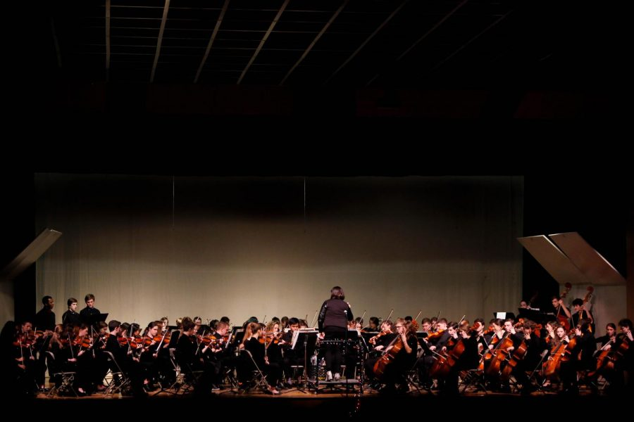 The senior orchestra and about 20 members of the HHS band, as well as some alumni, play