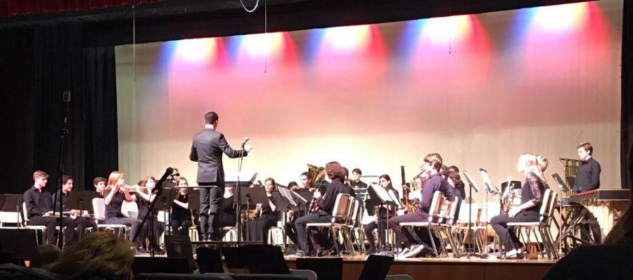 The Wind Ensemble preparing to play.