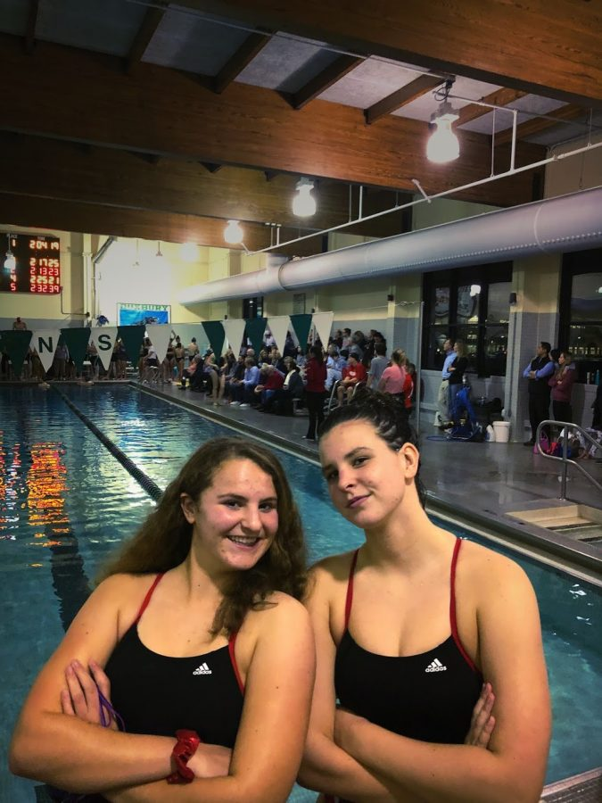 Juniors Hannah Leawack and Kate Connolly get pumped with a pose before the meet.