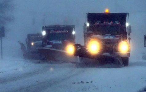Plows trying to clear up the roads for school starting up the next day in Hanover.
