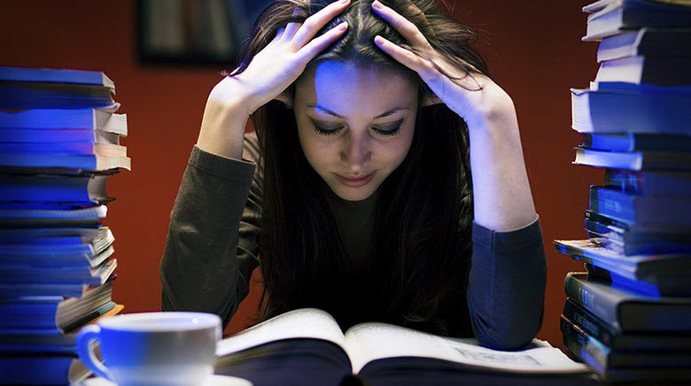 A student staying up late to complete her homework (Flickr).