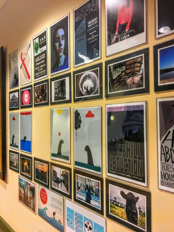 Graphic design pieces by students at Hingham High School line the walls of Town Hall.