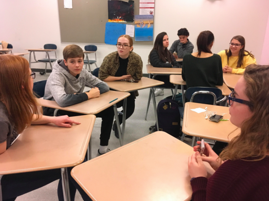 Junior Molly Ahern (far left) speaking to freshmen Nate Bourgon, Amanda Crosby (center), and Claire Gallagher (left) about upcoming events in the Mentor Program.
