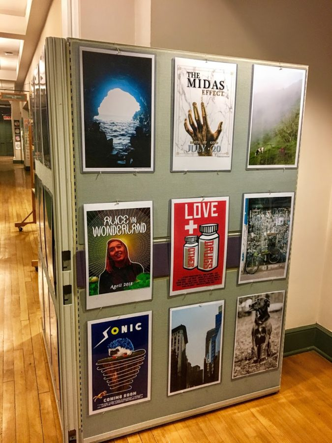 Pieces by graphic design students from Hingham High School hang in the hallways of Town Hall.
