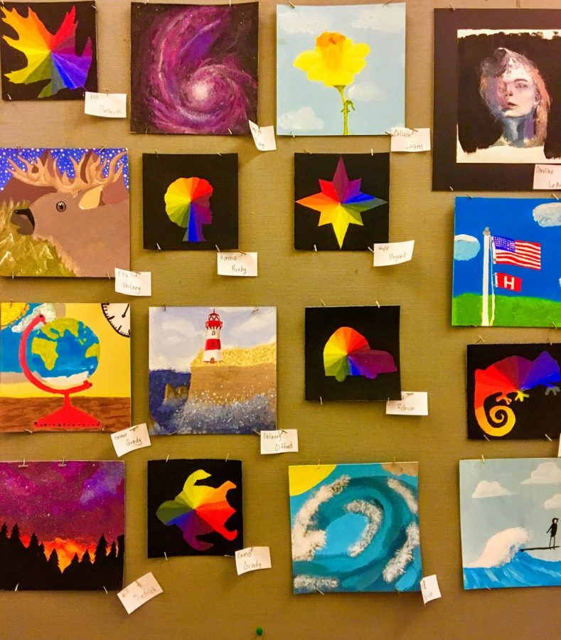 Pieces by students involved in the Drawing and Painting program at Hingham High school are displayed on a bulletin board on the second floor of the Town Hall.
