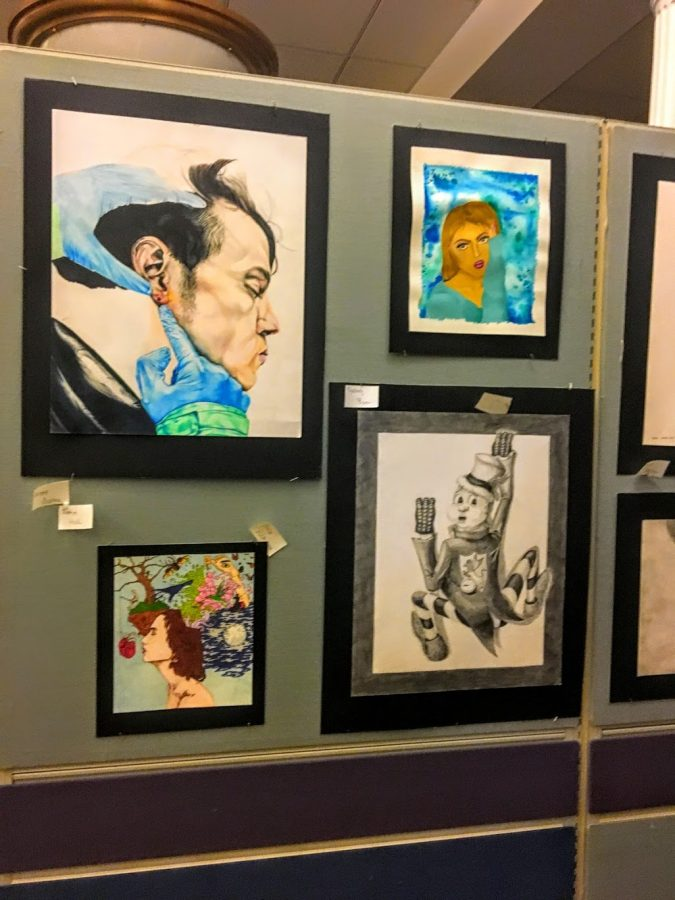 The work of advanced drawing and painting students is displayed in front of the Town Hall Auditorium.