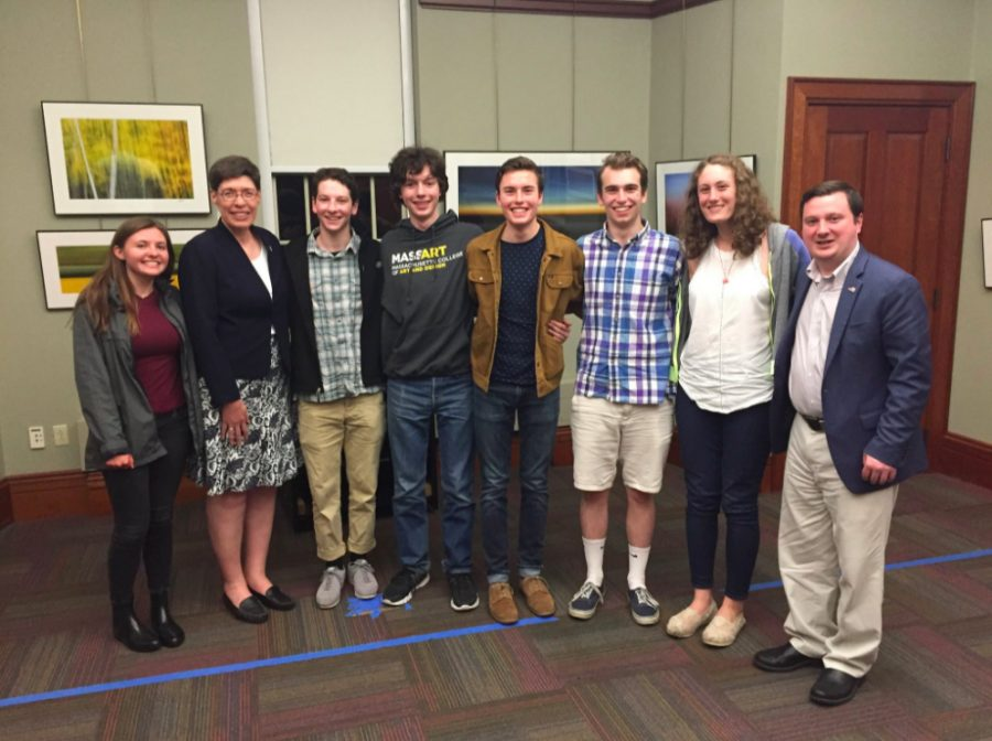 State Representative Joan Meschino (left) and State Senator Patrick O'Connor (right) with Hingham High School students (from left to right) Claire Taylor, Jack Meyers, Nick Thompson, Will Sutton, Will Brady, and Molly Schwall.  (Photo by Ryan Heffernan)