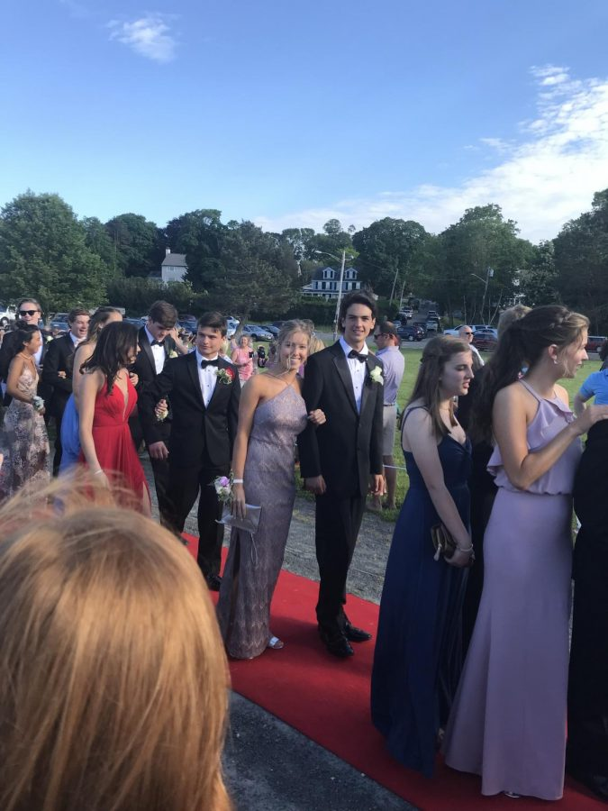 Prom-goers+walking+the+red+carpet+before+heading+to+Lombardo%27s+where+the+prom+itself+was+held.