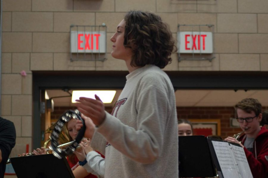 The+Hingham+High+School+Pep+Rally+Band+brought+up+the+energy+in+the+gym+as+people+filed+in.+Here%2C+senior+Molly+Schwall+rocks+it+on+the+tambourine.+