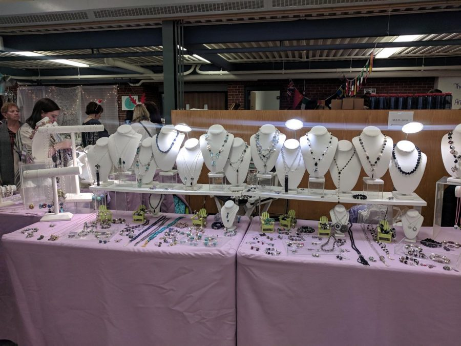 A local merchant displays beautifully, hand crafted jewelry in the HHS cafeteria on Saturday's Holiday fair.