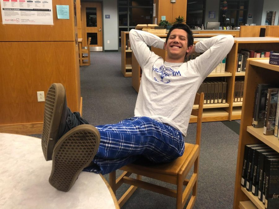 Senior James Winikoff lounges in his pajama day outfit.