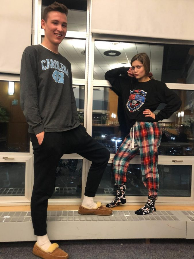 Juniors Emily Goldstein (Right) and Sean Kelly (Left) pose in their pajama day outfits at Homework Club.