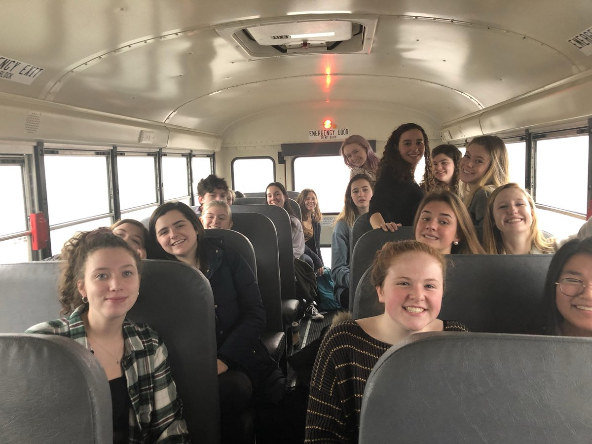 The eighteen delegates from HHS smile as they ride the but to the HMUN conference on Thursday, January 24th.