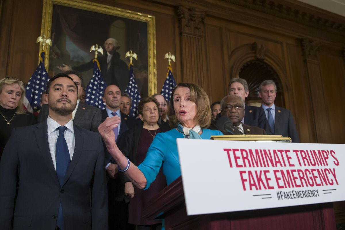 House Speaker Nancy Pelosi of California, alongside Rep. Joaquin Castro of Texas, left, as well as others, speaks about a resolution to block Trump's national emergency declaration.