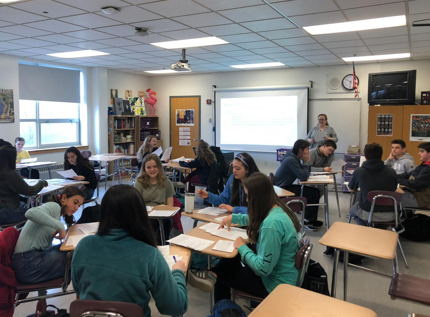 Ms. Roth's sophomore English class reviews sample MCAS essays in advance of taking the updated test this year.