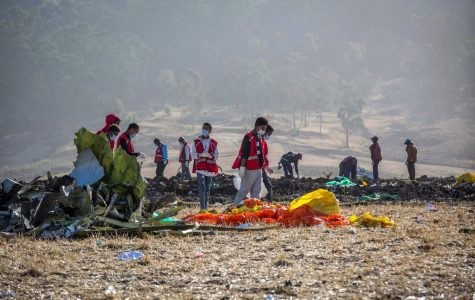 Rescuers clean and look through the site of the Ethiopian Airlines Flight 302 crash. (Mulugeta:Associated Press)