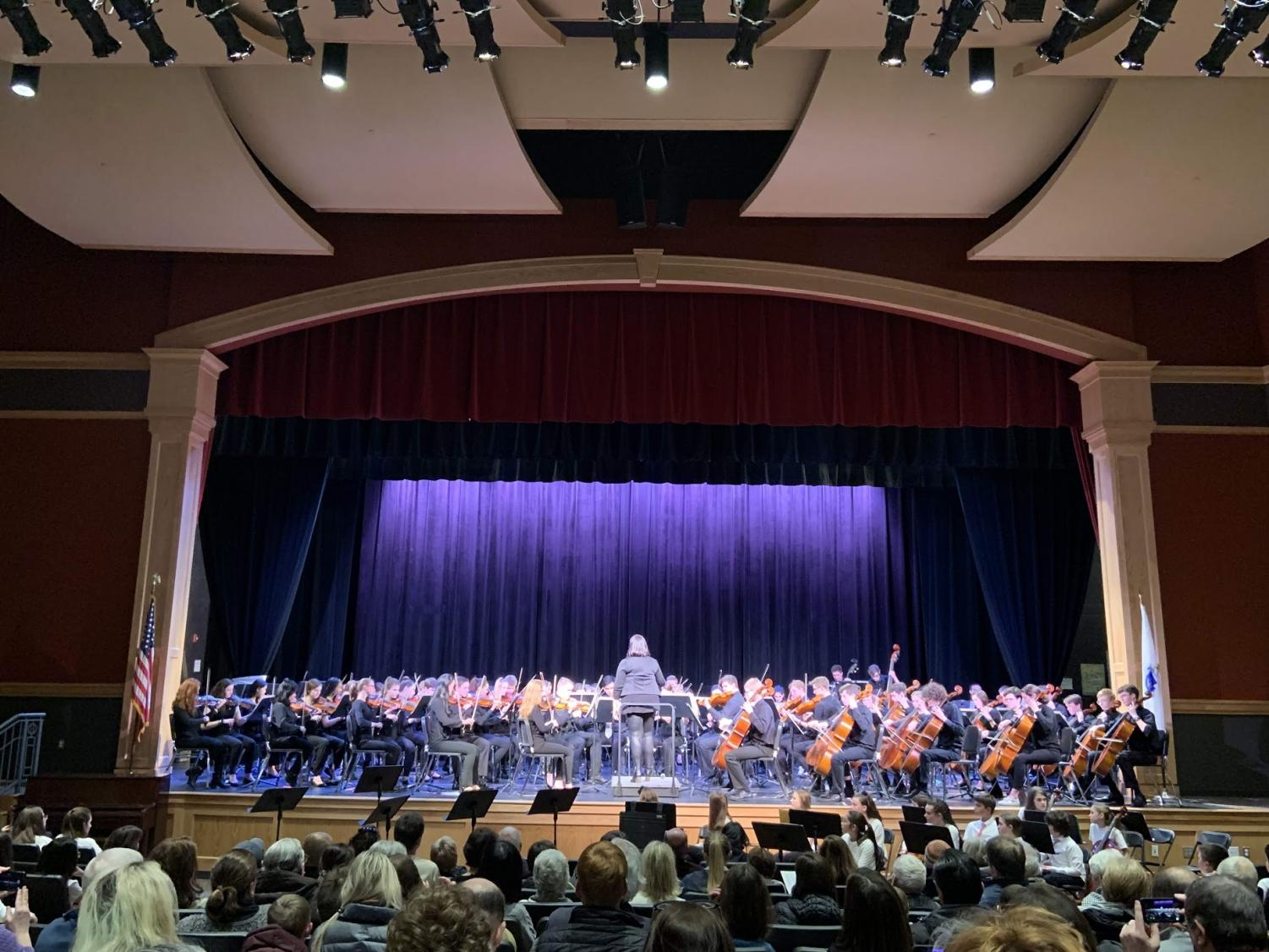 "The Hingham High School Orchestra, conducted by Phaedre Sassano, in their rendition of ""Crazy Train."""