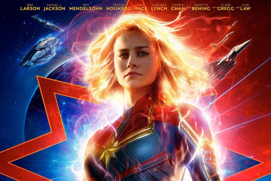 Brie Larson stands strong in the Captain Marvel movie poster.--and, no, she is not smiling, nor does she have to.