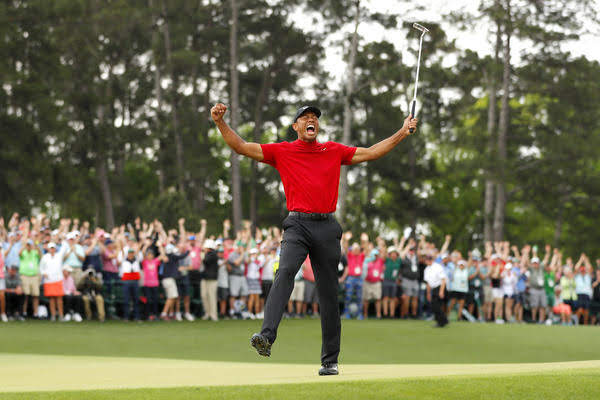 Tiger Woods celebrates in a moment of pure elation after winning his fifth Masters title.