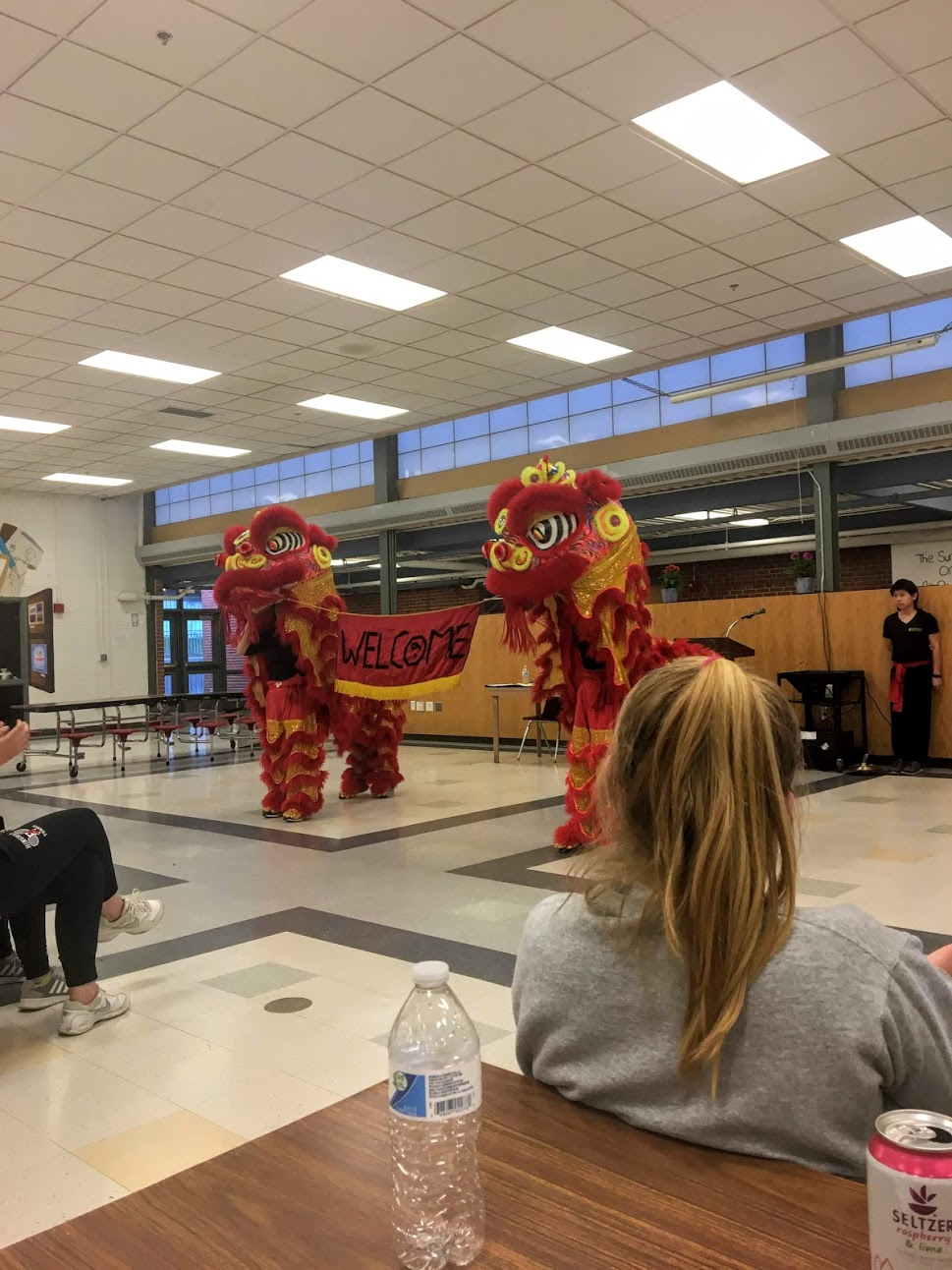 The Gund Kwok Asian Women's Lion and Dragon Dance Troupe welcomes seniors to the Global Symposium