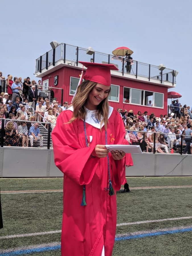 Leah O'Rourke admires her well earned diploma once it is in her hands.