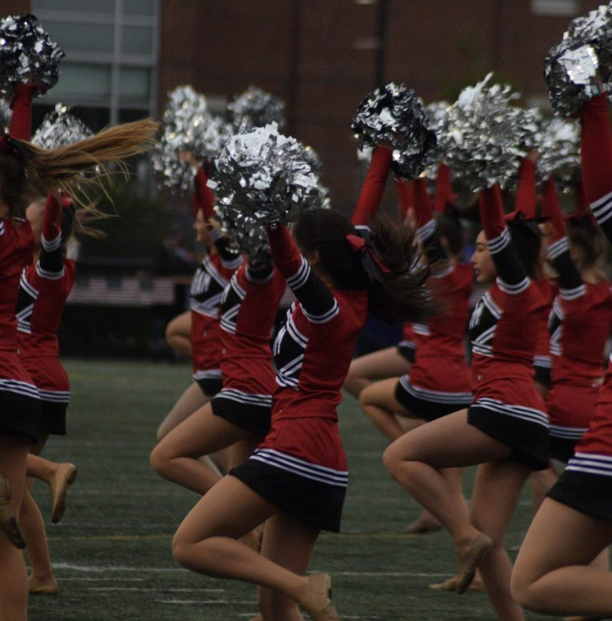 The Hingham High Dance Team shows their spirit during their half time routine.