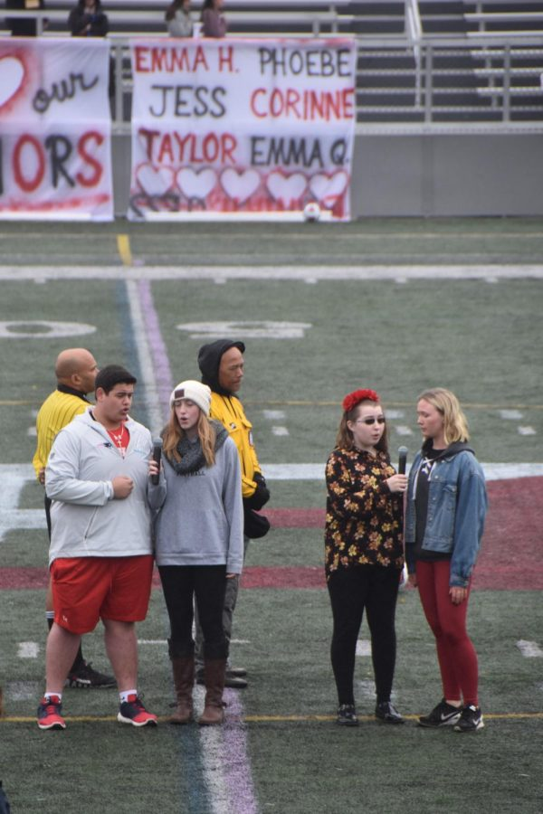 From Left: Seniors Nick Capodilupo, Mitzie Estes, Marina O'Callaghan, and Tess Leonard sing the national anthem prior to the start of the game.