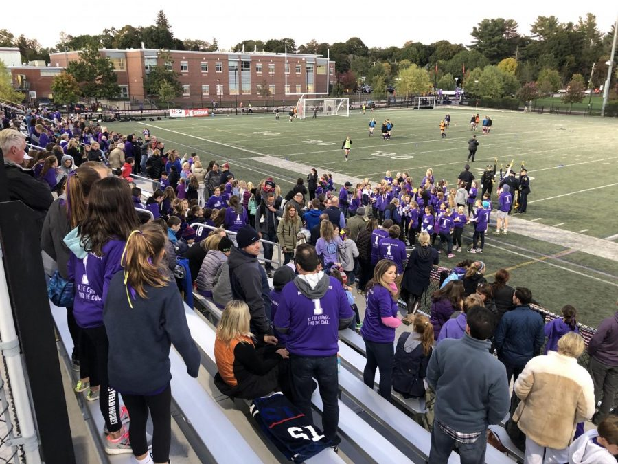 n the stands is a sea of purple clothing as families from surrounding towns showed up to donate and show support for Maddie's cause.