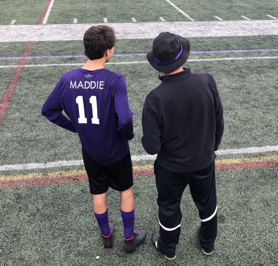 Matthew Ahern wearing the purple jersey with Maddie's name, along with the rest of the team, to show support for the cause