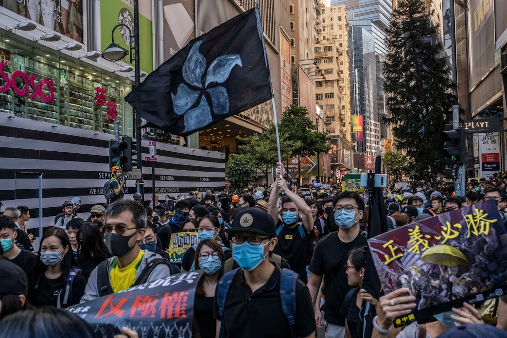 Protesters march peacefully through the Causeway Bay district of Hong Kong.