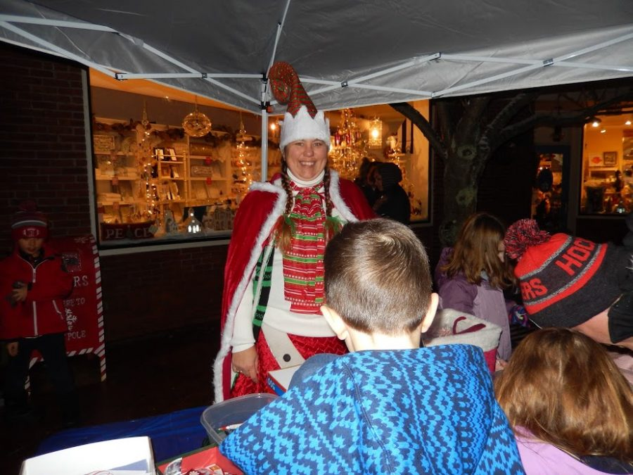 At Christmas in the square, children are given the opportunity to write letters to Santa at a booth.